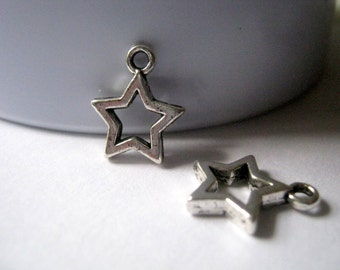 10 Silver Tone Star Charms   (1027)