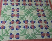 Applique tulip quilt in plain colors, double borders hand quilted  1940's