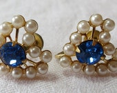 Vintage CORO signed screw back earrings. Heart shaped, brilliant sapphire toned, prong set central stone, faux pearls.KK16.6-7.10-2.