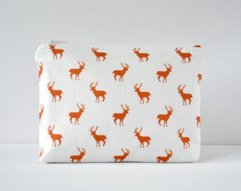 Padded woodland red stag deer silhouette cosmetics bag make up pouch in brown red and white.