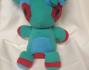 "13""  Blue, red,  & green  giraffe  Plush"