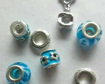Turquoise color glass beads and silver spacers