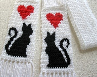 White Cat Scarf. Knit scarf with crochet black cat silhouettes and red hearts. Long, skinny scarf with cats