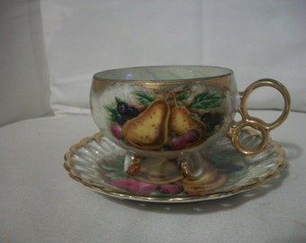 Vintage Royal Sealy Iridescent 3 Footed Tea Cup And Saucer Set