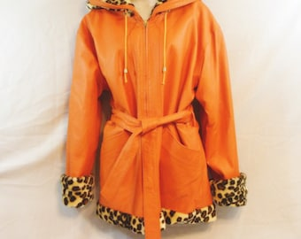 Vintage orange leather belted coat with hood.  faux leopard and  Reversible. Size medium to large