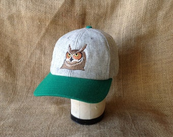 """6 panel light grey wool flannel ballcap with owl embroidery, 3"""" green visor, cotton sweatband, custom colors and cap sizes."""