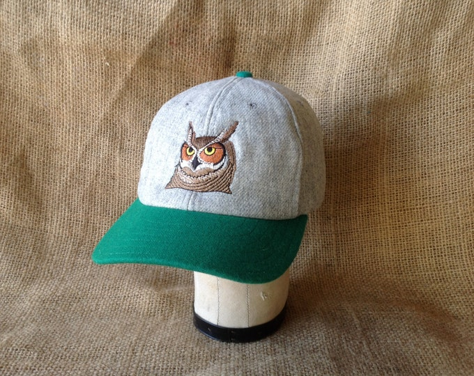 "6 panel light grey wool flannel ballcap with owl embroidery, 3"" green visor, cotton sweatband, custom colors and cap sizes."