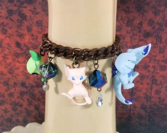 Awesome Legendary Pokemon Charm Bracelet with Lugia, Mew, Mewtwo, Jirachi, and Celebi - Jewelry