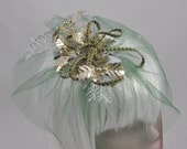 Party Steampunk Fascinator / mini hat with green veil, gold holly, icy pine, and green/gold ribbon OOAK