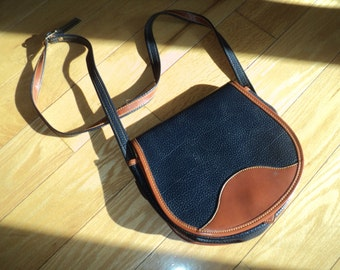Vintage Cross Body Saddle Style Purse in Navy Blue Leather looking material with brown leather looking trim and blue suede interior lining