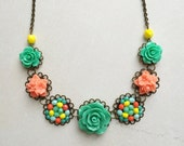 Necklace in coral, yellow and dark mint