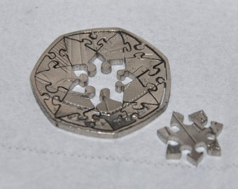 Heptagram. Coin cut puzzle. 16 pcs. 50 pence coin