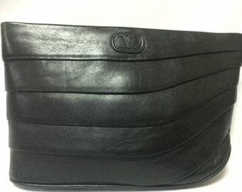 80's Vintage Valentino Garavani black leather wave layered design clutch bag, purse with V logo. Classic unisex purse for daily use.