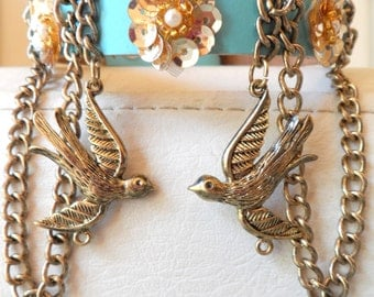 Swallows and flowers. Delicate, detailed, suspended, metal swallows, gold color loop chains,sequin flowers and seed pearls. OOAK