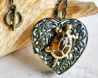 Music box locket,  heart shaped locket with music box inside, in bronze with a amber and gold tone turtle.