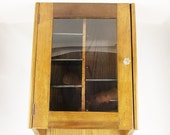 A Wood Cabinet With Movable Shelves - Hang on a Wall - Glass Front - Left or Right Opening - Glass Handled Knob