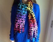 A  Fleece scarf ,colorful with peace signs.Neck scarf,light weight and warm .