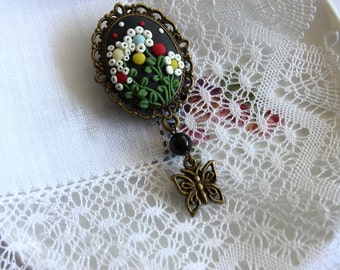 Brooch of polymer clay with floral motive. Spring/summer jewelry.