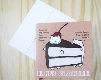"""CARD: """"Cake Cats"""" featuring a cat in a cake slice suit with a handmade cherry hat and his gullible buddy"""