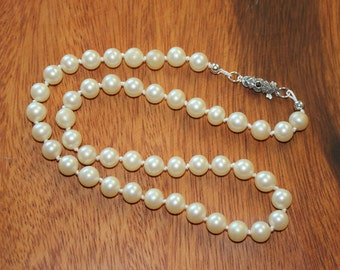 Vintage Glass Pearl Necklace hand knotted with Sterling Silver findings.