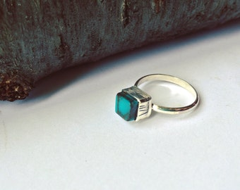 Turquoise cube with stamped bezel