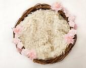 Newborn nest with pink flower garland