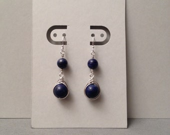 Sterling silver wire wrapped hand made earrings with lapis lazuli.