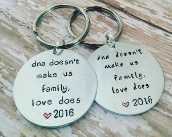 Custom hand stamped adoption keychain, step family jewelry, step parent gift, adoption gift, inlaw gift, dna doesnt make us family love does