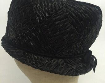 Vintage Mr. John Classic Black Cello Straw Hat.1960's.Women's hat.Diamond pattern.Thin velvet crossing straps front and back.Black cloche.