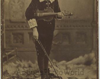 Sad boy with violin antique music photo