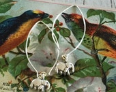Stamina. Drop earrings made from sterling silver showcase small, fine silver elephants. By ladeDAH! Jewelry.