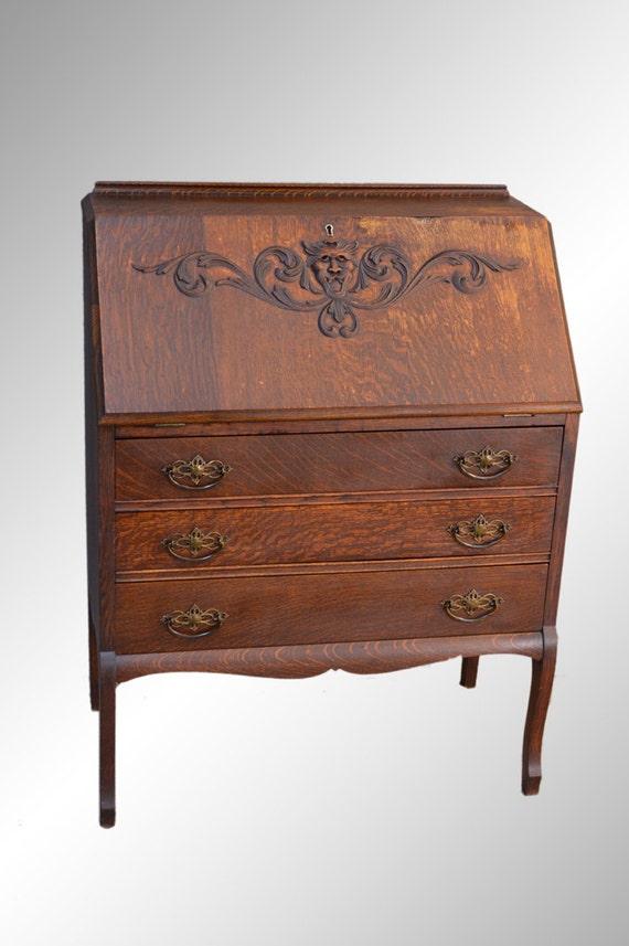 Antique victorian oak slant top desk with lion face