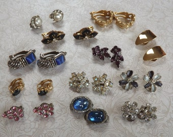 12 pair of vintage jewelry clip on earrings in gold & silvertone metal in different designs and set with different types of stones or enamel