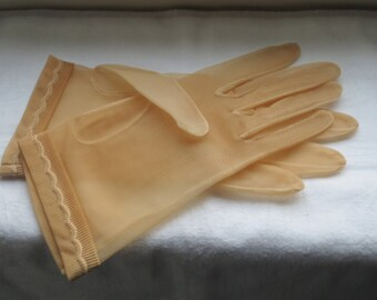 Vintage pair of nylon translucent chiffon gloves. Butterscotch colour size 6. As new from the 1960s.