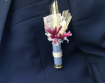 Boutonniere designed in with a spent shotgun shell