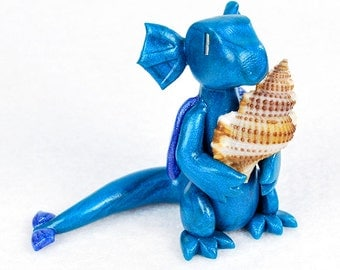 Teal blue dragon holding seashell - water dragon figurine - polymer clay dragon sculpture - little dragon desk ornament