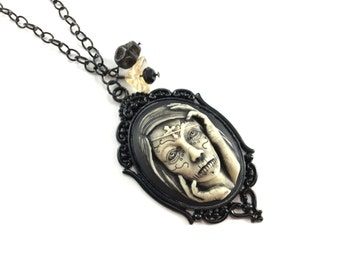 Day of the Dead Cameo Necklace — Perfect for Halloween! Beautiful Dia Los Muertos woman on a black chain with black and cream glass beads