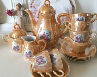 Vintage Pearl lustre Portrait coffee set with pot, lidded sugar bowl, creamer and six espresso cups.