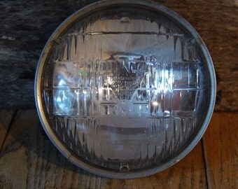 vintage car headlight - automotive metal and glass