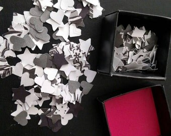 Black, White, and Silvery Confetti in Hearts, Stars, and Flowers.