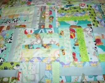 Baby Quilt is green using log cabin design.