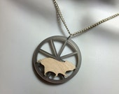 "Laser cut ""Hamster in a wheel"" necklace"
