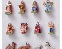 Miniature Christmas Nativity Set for kids decorating the mini Christmas tree