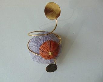 An adjustable- gold plated sea urchin bracelet,  real sea treasure.