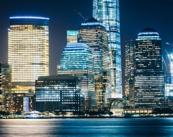 View of the Lower Manhattan skyline at night, Exchange Place, Jersey City, New Jersey. | Photo Print, Stretched Canvas, or Metal Print.