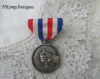 Old medal with ribbon