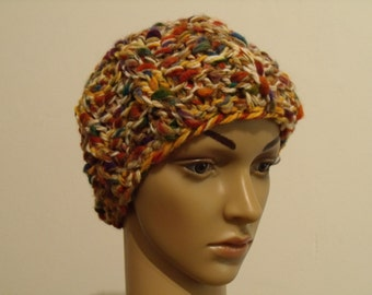 Colorful thick knitted hat with cable pattern