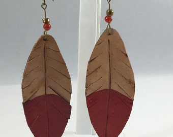 Beaded textured feather design earrings in muted red