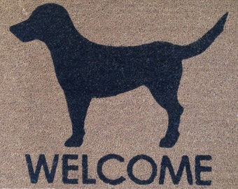 Black lab with welcome