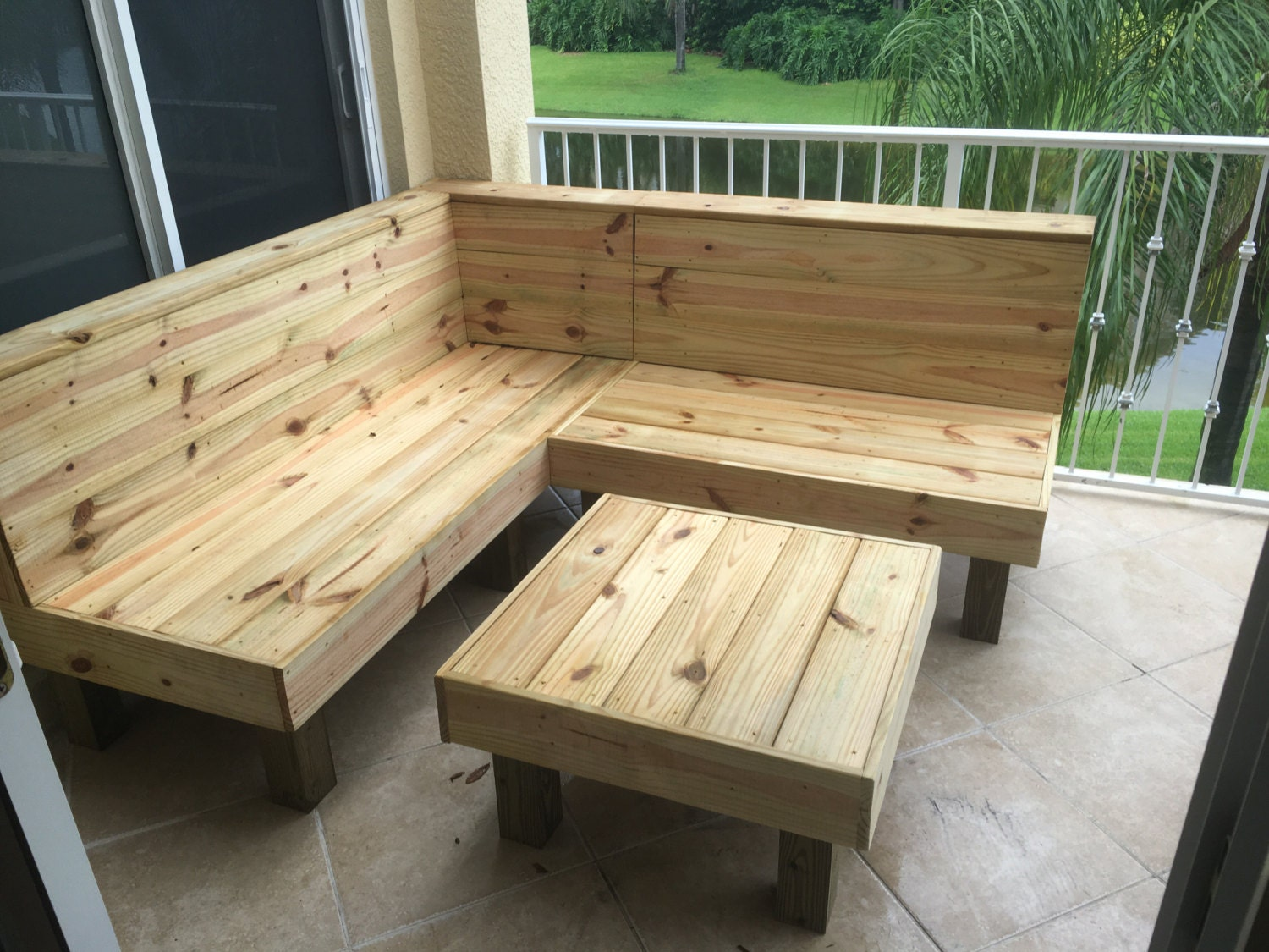 The sectional rustic wood patio benches and table or for Outdoor furniture benches